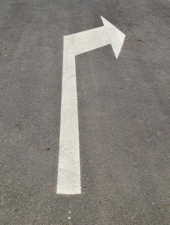 arrow signs on the asphalt road photo