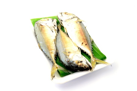 Chub mackerel on a banana leaf isolate on white background Stock Photo