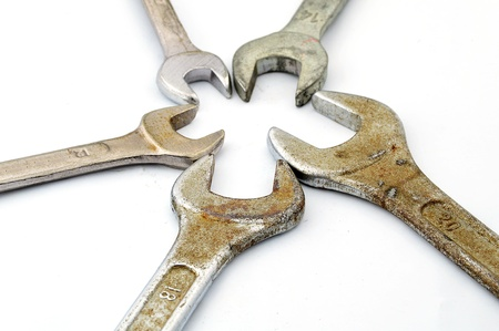 various sizes of old wrenches isolate on white background