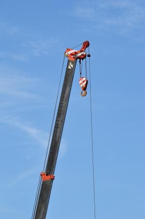 erect: crane with blue sky element of design