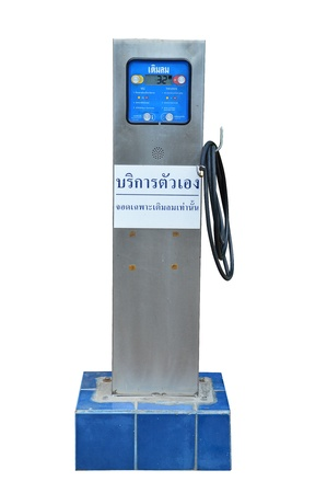 power operated: automatic tire pump isolate on white background, Thai langauge on white plate means  Self Service inflat tire parking only  not brandname Stock Photo