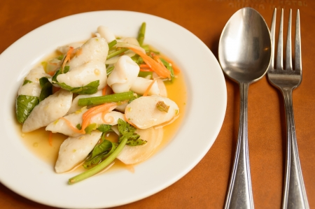 spicy fish balls salad on restaurant table