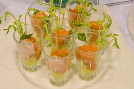fresh salmon and shrimp salad appetizer in glass