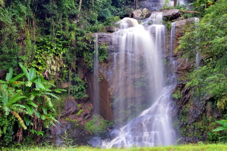 waterfall in green forest in Thailand Stock Photo