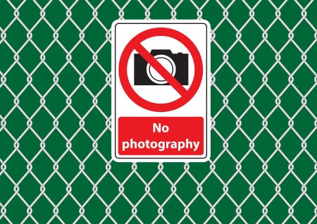 cautions: wire mesh fence with no photography signs vector images