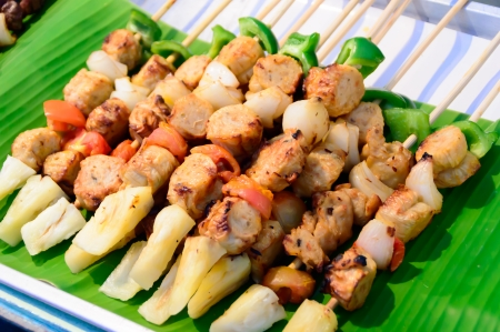 chicken barbecue stick on banana leaf in local market, Thailand Stock Photo