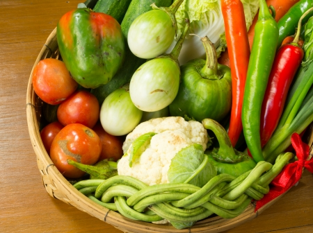 fresh vegetable in basket on wooden table Stock Photo
