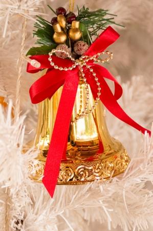 christmas bells hanging on tree