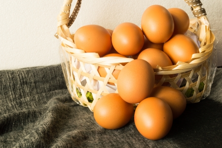 still life of Heap brown chicken eggs in wicker basket