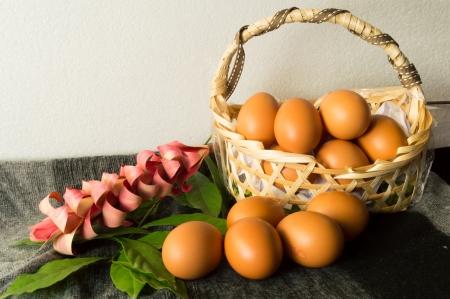 still life of Heap brown chicken eggs in wicker basket