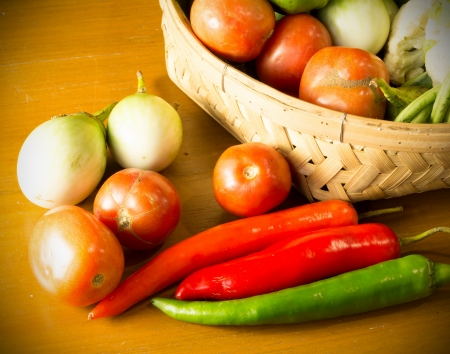 fresh vegetable with basket on wooden table still life Stock Photo