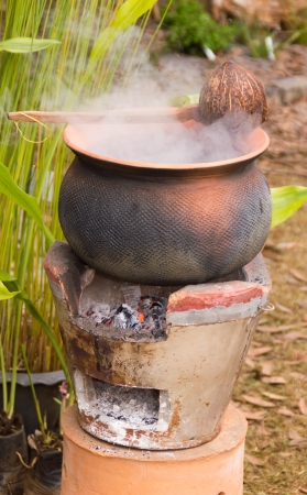 clay pot with boil food on fire in Thailand
