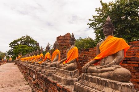 aligned: AYUTTHAYA,THAILAND-JUNE 27, 2013  Aligned statues of Buddha in Watyaichaimongkol