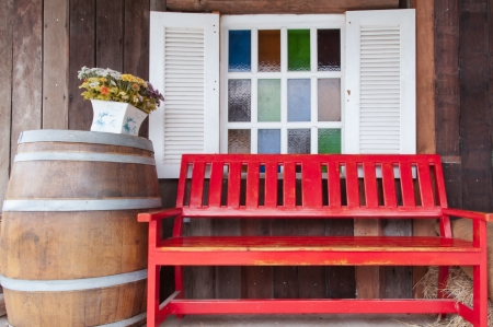 red bench in front of multi colour glasses of window  Stock Photo - 23065496