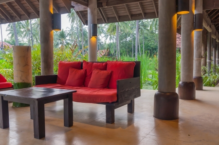 Red seat in veranda  and natural background scene