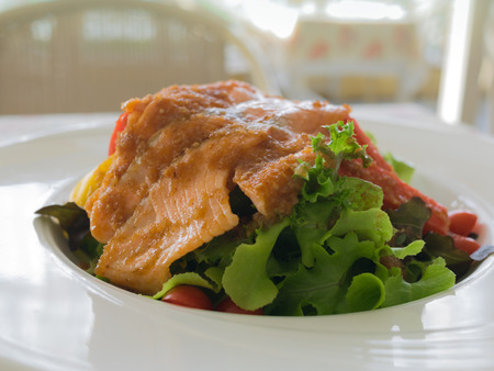 Delicious salmon salad in white bowl http:www.istockphoto.comphotopasta-salad-with-smoked-salmon-16231247?st=fccd4fd http:www.istockphoto.comphotosmoked-salmon-salad-12325669?st=fccd4fd photo