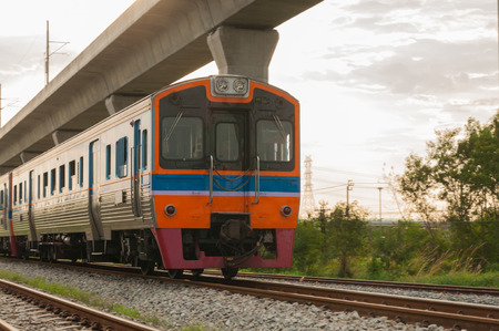forceful: Railroad locomotive traveling in Thailand