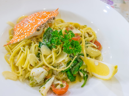 ready to eat: Delicious spicy crab spaghetti on white plate ready to eat.