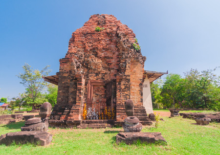lintel: Out side of Phra That Dum, is the lone Stupa is built with laterite in the same period as Phra That Narai Cheng Weng, but the stupa is smaller without base. The lintel featuring God Vishnu in reclining position is placed on the northern arch.  Stock Photo