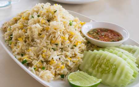 lunchtime: Khao phat pu, Fried rice with crabmeat,  Thai food lunchtime dish of Thai rice, Fried rice with crabmeat and mix onion, egg table.