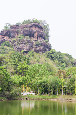 dwell: Big stone was renovated at Phu Tok for dwell , mountain in Wat Je Ti Ya Ki Ree Vi Harn. is tourist attraction with wooden trail round of the 7 floors mountain.