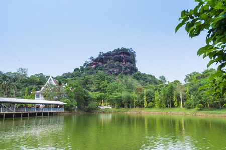 Big stone was renovated at Phu Tok for dwell , mountain in Wat Je Ti Ya Ki Ree Vi Harn. is tourist attraction with wooden trail round of the 7 floors mountain.