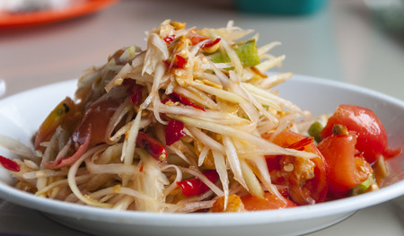Close up of famous Thai food, papaya salad or what we called Somtum in Thai