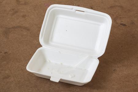 unclean: Unclean food foam box with plastic spoon.