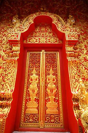 Traditional Thai art church door of Wat Sri-Chum, Lampang province, Thailand Stock Photo