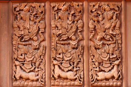Traditional Thai style wood carving, Wat Banden Maetang Chiangmai, Thailand Stock Photo