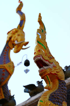 Serpent Image on front temple, Wat Banden Maetang Chiangmai, Thailand