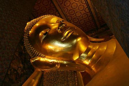 BANGKOK THAILAND- SEPTEMBER 24  Buddha statue in the Temple of The Reclining Bhudda or WAT PHRA CHETTUPHON WIMON MANGKHLARAM RATCHAWORAMAHAWIHAN September 24, 2006 in Bangkok, Thailand  Editorial