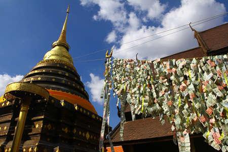 Making merit in Wat Phra That Lampang Luang, Lampang Thailand Stock Photo