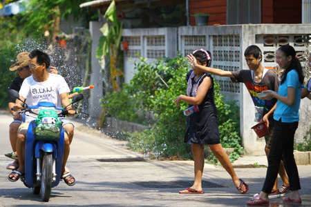 LAMPANG,THAILAND - APRIL 13: Songkran Festival is celebrated in Lampang Province,Thailand as the traditional New Years Day from 13 to 15 April by throwing water at each other, on 13 April 2012 in Lampang Province,Thailand