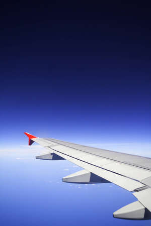 Looking through window airplane during flight in wing with a nice blue sky  photo