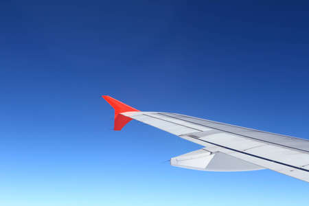 Looking through window airplane during flight in wing with a nice blue sky