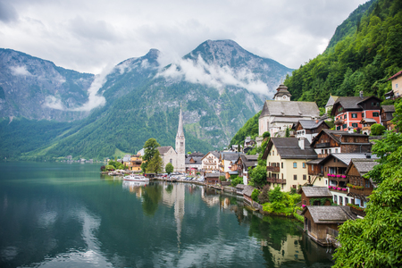 Hallstatt village  with clouds and mountain in lake of Austria World heritage