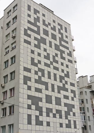 Building with a crossword puzzle painted on the wall (Lviv, Ukraine)