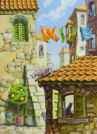 The different cats at the various places of the old Mediterranean city Stock Photo