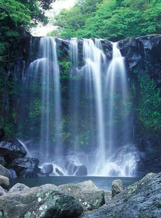 Famous Chunjeyun Waterfall of Jeju island in South Korea.  photo