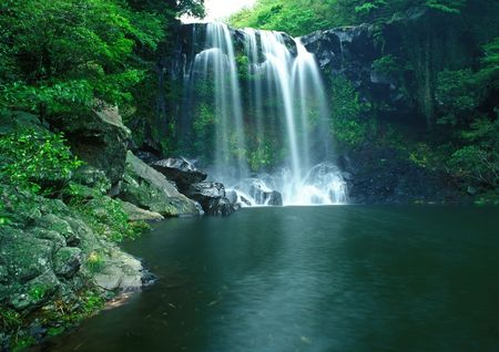 Famous Chunjeyun Waterfall of Jeju island in South Korea.  photo