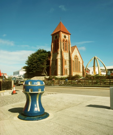 port stanley: Christ Church Cathedral of Port Stanley Puerto Argentino jawbones of Blue Whale in foreground United Kingdom Falkland Islands