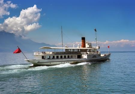 Vintage cruise ship crossing Geneva lake,France photo