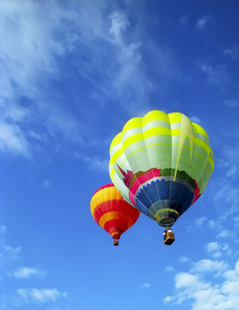 moving activity: Two beauty ballooons flying in sunny blue sky