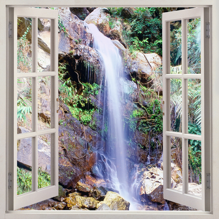 Open window view to small water cascade Stock Photo