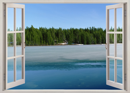 Open window view to lake with ice in spring