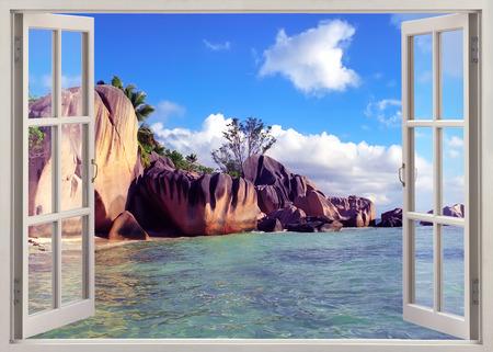 Open window view to  old stones coastline Seychelles Stock Photo