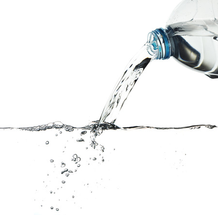 Water pour from water bottle, with clipping path