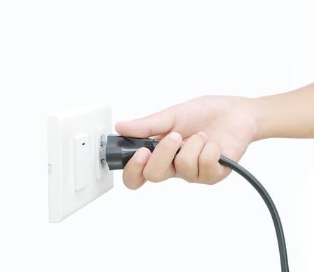 Hand holding plug , Unplug or plugged 写真素材