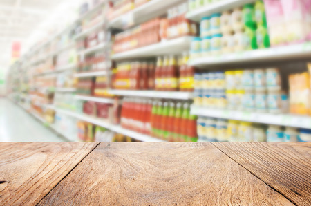 Wood floor and Supermarket blur background ,Product shelf sauce